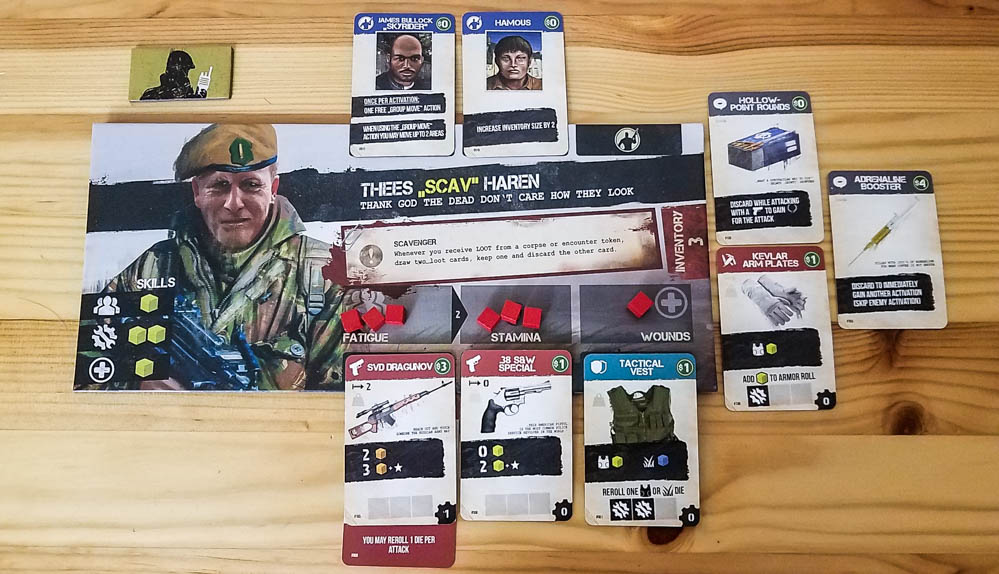 Jagged Alliance The Board Game review - merc and his gear